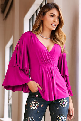 Solid cold shoulder v-neck knit top