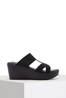 Elastic slide wedge heel